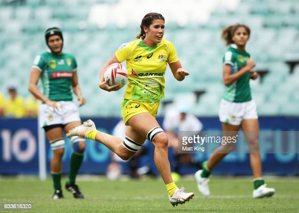 Charlotte Caslick of Australia scores a try during the womens pool match between Australia and South Africa in the 2017 HSBC Sydney Sevens at Allianz...