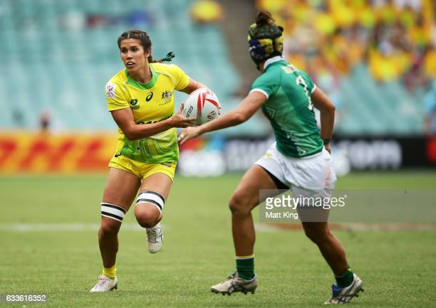 Charlotte Caslick of Australia takes on the defence during the womens pool match between Australia and South Africa in the 2017 HSBC Sydney Sevens at...