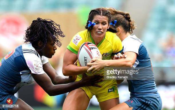 Charlotte Caslick of Australia takes on the defence in the match against France during day one of the 2018 Sydney Sevens at Allianz Stadium on...