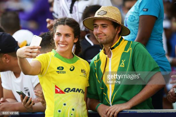Charlotte Caslick of Australia takes selfies with fans during the 2017 HSBC Sydney Sevens at Allianz Stadium on February 4 2017 in Sydney Australia