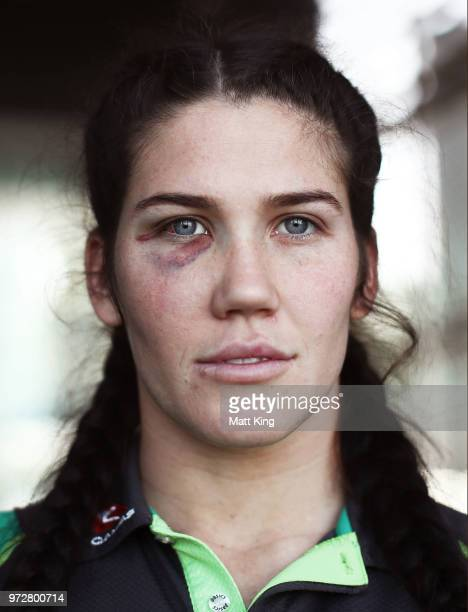 Charlotte Caslick of the Australian Women's Sevens team poses following their 20172018 Sevens World Series victory at the Rugby Australia Building on...