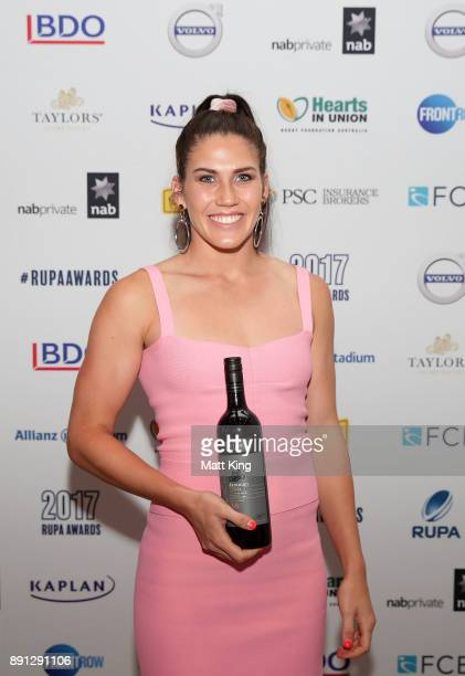 Charlotte Caslick poses after winning the People's Choice Australian Player of the Year award during the RUPA Awards Lunch at The Ivy on December 13...