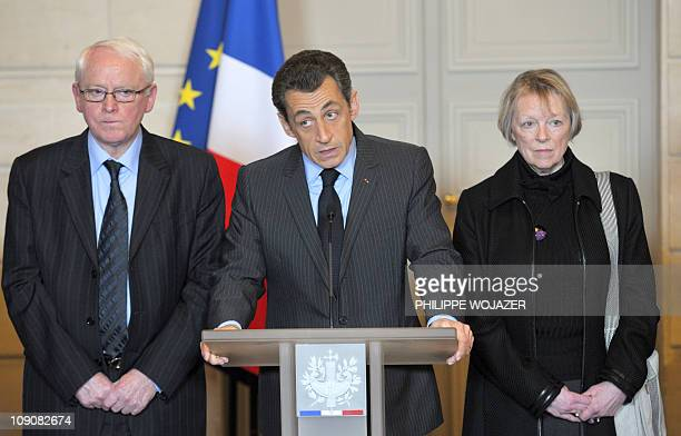 Charlotte Cassez and Bernard Cassez the parents of Florence Cassez listen to France's President Nicolas Sarkozy as he delivers a speech after a...