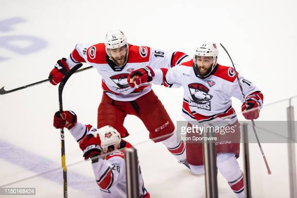 Charlotte Checkers center Clark Bishop center Nicolas Roy celebrate right wing Zach Nastasiuk a goal during game five of the AHL Calder Cup Finals...
