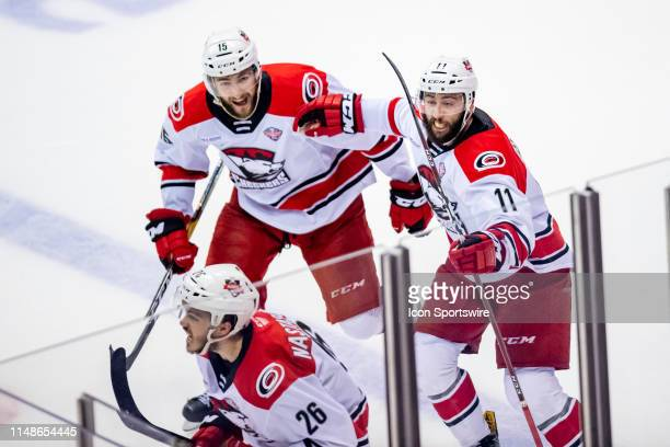 Charlotte Checkers center Nicolas Roy and Charlotte Checkers center Clark Bishop celebrate a goal with Charlotte Checkers right wing Zach Nastasiuk...