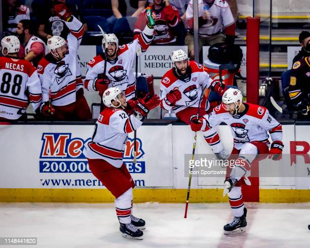 Charlotte Checkers center Nicolas Roy celebrates an empty net goal with center Clark Bishop right wing Julien Gauthier left wing Tomas Jurco in the...