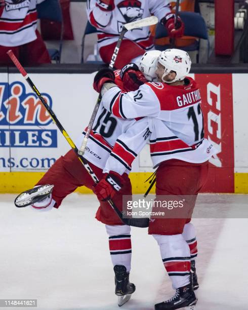 Charlotte Checkers center Nicolas Roy celebrates his empty net goal with Charlotte Checkers right wing Julien Gauthier in the third period during...