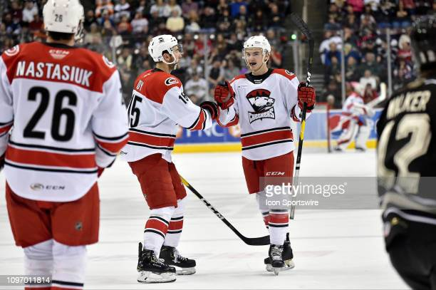 Charlotte Checkers center Nicolas Roy congratulates Charlotte Checkers defenseman Jake Bean after Bean's third period goal during the Charlotte...