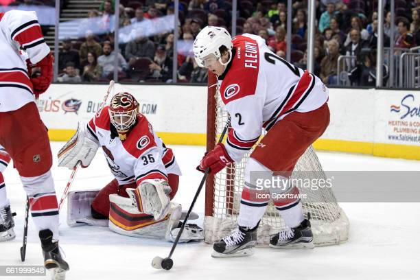 Charlotte Checkers D Haydn Fleury controls the puck next to Charlotte Checkers G Tom McCollum during the second period of the AHL hockey game between...