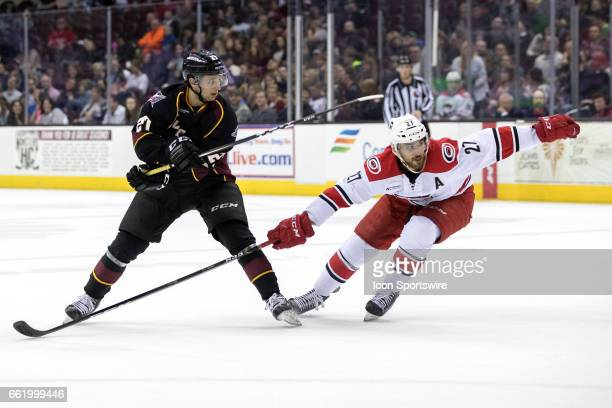 Charlotte Checkers D Jake Chelios defends Cleveland Monsters RW Daniel Zaar during the second period of the AHL hockey game between the Charlotte...