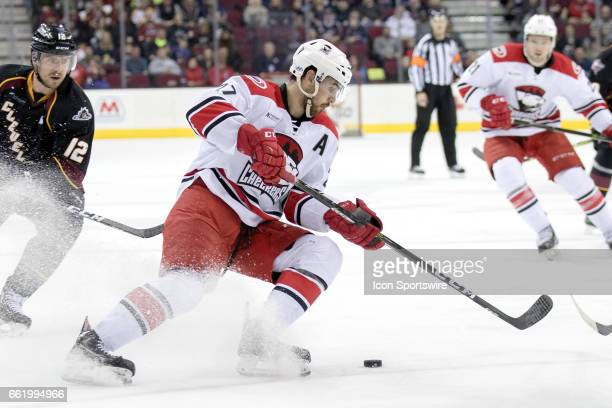 Charlotte Checkers D Jake Chelios plays the puck during the third period of the AHL hockey game between the Charlotte Checkers and Cleveland Monsters...