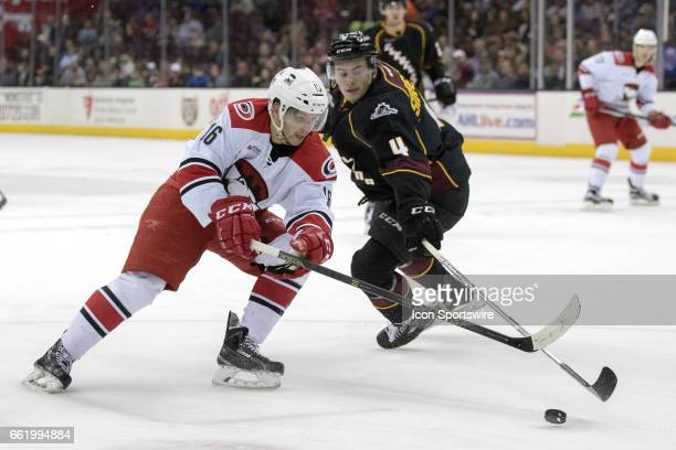 Charlotte Checkers LW Sergey Tolchinsky drives to the net as Cleveland Monsters D Blake Siebenaler defends during the third period of the AHL hockey...