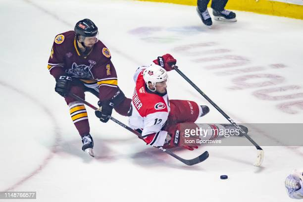 Charlotte Checkers right wing Julien Gauthier and Chicago Wolves defenseman Nic Hague battle for the puck during game four of the AHL Calder Cup...