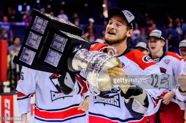 Charlotte Checkers right wing Julien Gauthier celebrates after game five of the AHL Calder Cup Finals against the Chicago Wolves on June 8 at the...