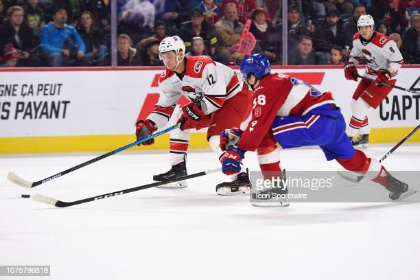 Charlotte Checkers right wing Julien Gauthier tries to shoot behyond Laval Rocket defenceman Cale Fleury during the Charlotte Checkers versus the...