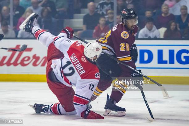 Charlotte Checkers right wing Julien Gauthier trips over Chicago Wolves right wing Keegan Kolesar in the first period during game three of the AHL...