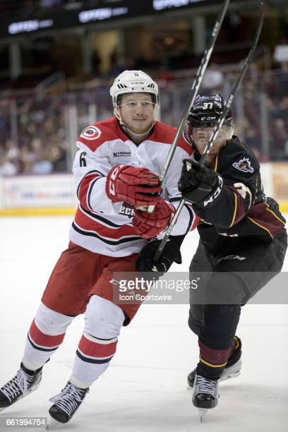 Charlotte Checkers RW Danny Kristo is defended by Cleveland Monsters LW Markus Hannikainen during the third period of the AHL hockey game between the...