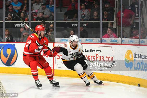 Charlotte Checkers Zach Nastasiuk battles Chicago Wolves Curtis McKenzie for the puck behind the net during game one of the Calder Cup finals between...