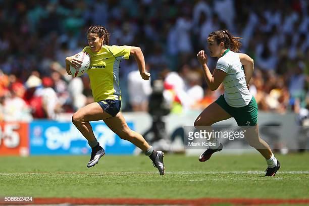 Charlotte Clarke of Australia makes a break during the 2016 Sydney Sevens women's exhibition match between Australia and Ireland at Allianz Stadium...