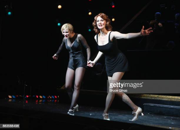 Charlotte d'Amboise as 'Roxie Hart' and Leigh Zimmerman as 'Velma Kelly' take the curtain call as Todrick Hall takes his first bow as 'Billy Flynn'...
