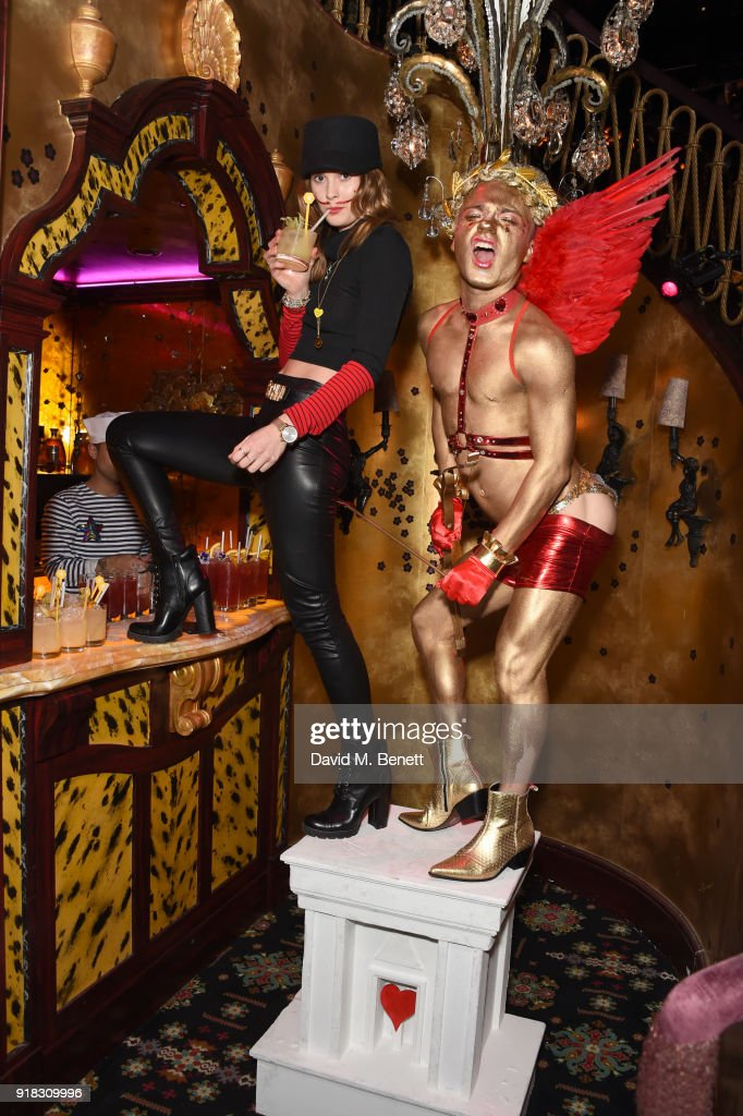 Charlotte de Carle (L) attends the 'Valentines is a Drag' party, in association with the dating app Bumble, at Loulou's on February 14, 2018 in London, England.
