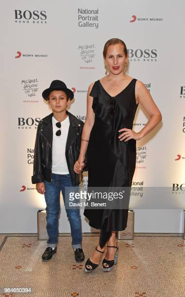 Charlotte Dellal and son attend a private view of the 'Michael Jackson On The Wall' exhibition sponsored by HUGO BOSS at the National Portrait...