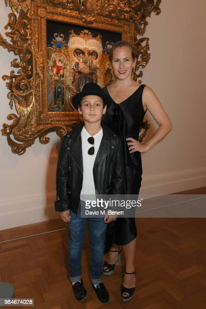 Charlotte Dellal and son attends a private view of the 'Michael Jackson On The Wall' exhibition sponsored by HUGO BOSS at the National Portrait...