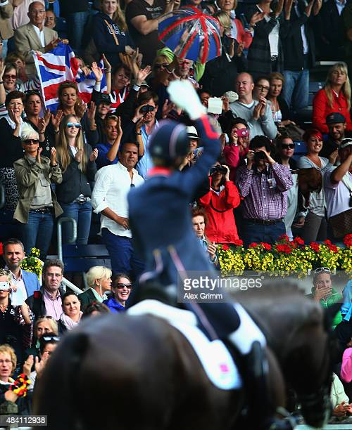 Charlotte Dujardin of Great Britain celebrates on her horse Valegro during the Dressage Grand Prix Special Individual Final on Day 4 of the FEI...