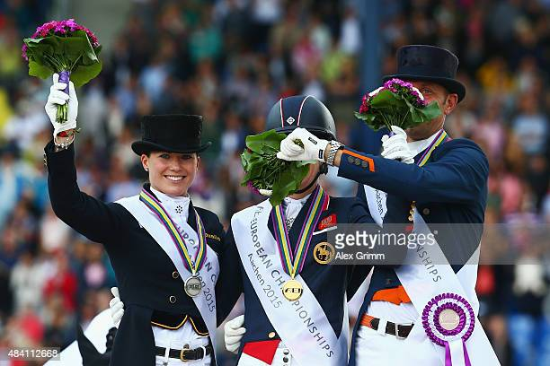 Charlotte Dujardin of Great Britain celebrates winning the Dressage Grand Prix Special Individual Final with second placed Kristina BroeringSprehe of...
