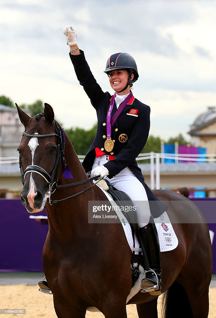Charlotte Dujardin of Great Britain on Valegro celebrates with her gold medal during the medal cerermony for the Team Dressage on Day 11 of the London 2012 Olympic Games at Greenwich Park on August 7, 2012 in London, England.