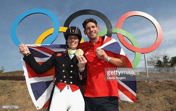 Charlotte Dujardin of Great Britain poses with her fiance Dean Wyatt Golding after winning the gold medal during the Dressage Individual Grand Prix...