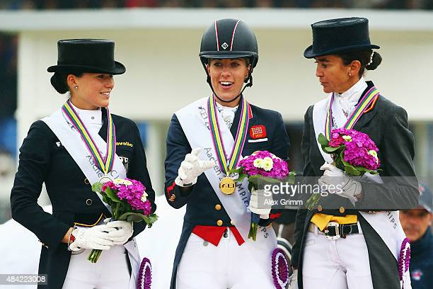 Charlotte Dujardin of Great Britain poses with second placed Kristina BroeringSprehe of Germany and third placed Beatriz FerrerSalat of Spain after...