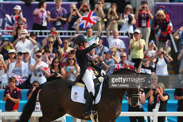 Charlotte Dujardin of Great Britain riding Valegro celebrates with her gold medal during the medal ceremony following the Individual Dressage on Day...