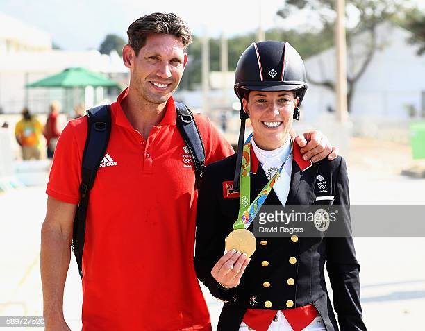 Charlotte Dujardin of Great Britain walks with her fiance Dean Wyatt Golding after winning the gold medal during the Dressage Individual Grand Prix...