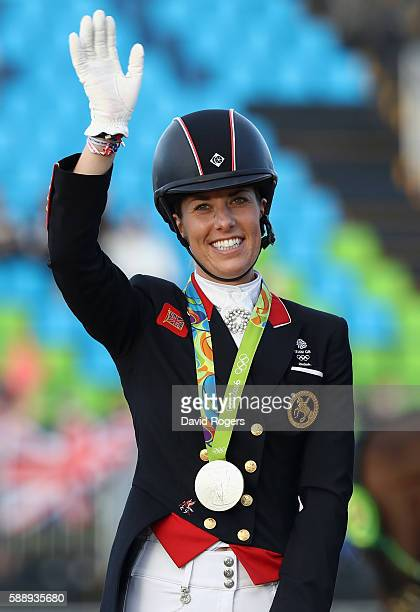 Charlotte Dujardin of Great Britain who won a team silver celebrates during the final day of the Dressage Grand Prix event on Day 7 of the Rio 2016...