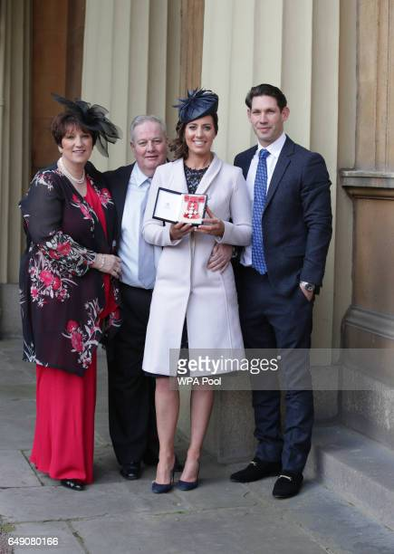 Charlotte Dujardin partner Dean Golding and parents Jane and Ian Dujardin after she was awarded a CBE by Queen Elizabeth II during an Investiture...
