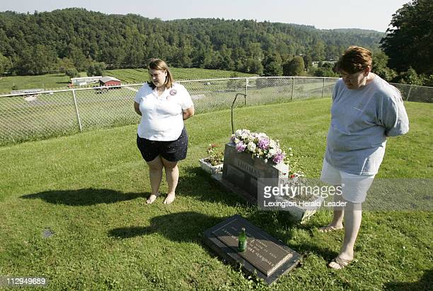 Charlotte Earhart right and her daughter Andrea Earhart Stauter visit the grave of Charlotte's son Ed Earhart at the family cemetery near Morehead...