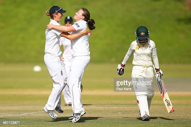 Charlotte Edwards and Anya Shrubsole of England celebrate the dismissal of Nicole Bolton of Australia during day two of the women's tour match...