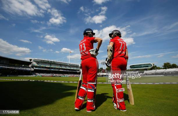 Charlotte Edwards and Arran Brindle of England wait before heading out to bat during the first NatWest One Day International match between England...