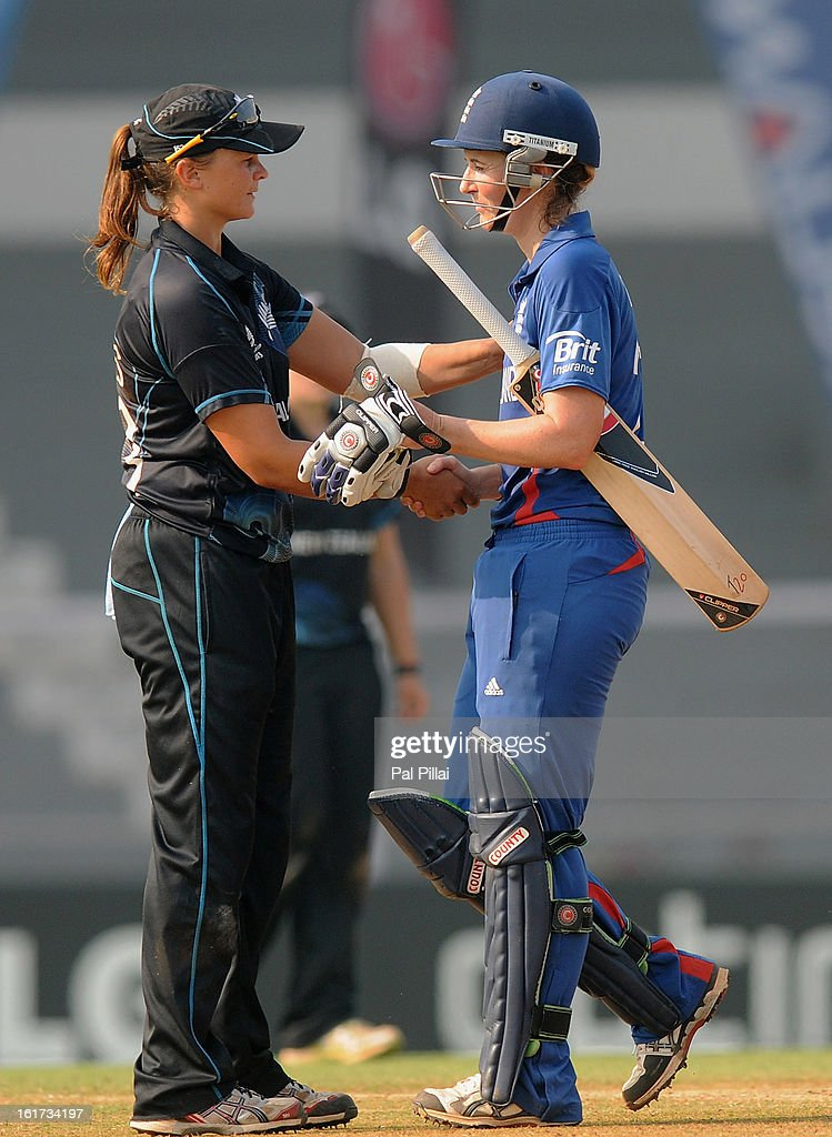 Charlotte Edwards captain of England is congratulated by Suzannah Bates of New Zealand as England wins the 3rd/4th Place Play-Off game between England and New Zealand held at the CCI (Cricket Club of India) ground on February 15, 2013 in Mumbai, India.
