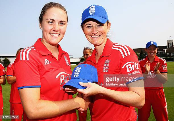 Charlotte Edwards Captain of England presents Natalie Sciver with her cap ahead of the 1st NatWest Women's International T20 match between England...