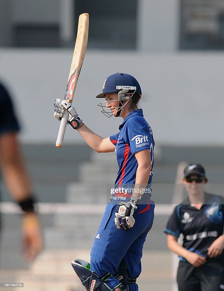 Charlotte Edwards captain of England raises her bat after scoring a century during the 3rd/4th Place Play-Off game between England and New Zealand held at the CCI (Cricket Club of India) ground on February 15, 2013 in Mumbai, India.