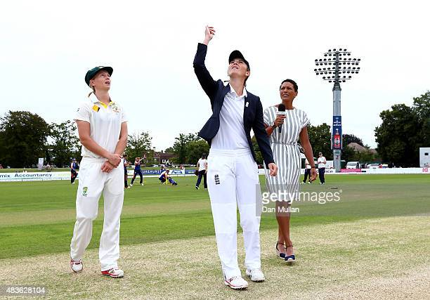 Charlotte Edwards Captain of England tosses the coin as Mag Lanning Captain of Australia looks on during day one of the Kia Women's Test of the...