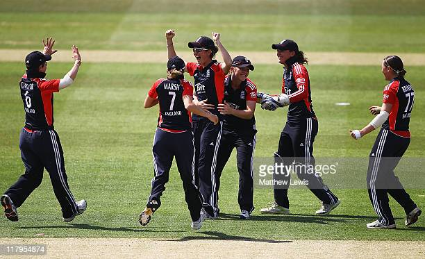 Charlotte Edwards of England celebrates catching Lucy Doolan of New Zealand during the NatWest Women's Quadrangular Series match between England and...