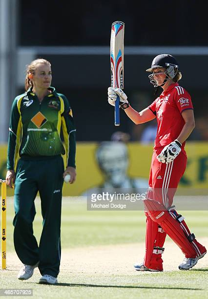 Charlotte Edwards of England celebrates her half century during game one of the International Twenty20 series between Australia and England at...