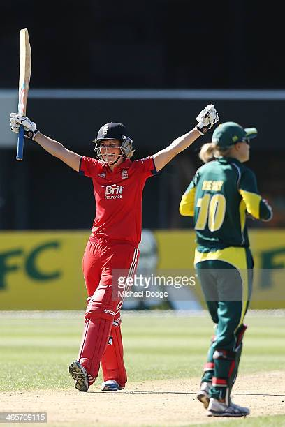 Charlotte Edwards of England celebrates hitting the winning runs during game one of the International Twenty20 series between Australia and England...
