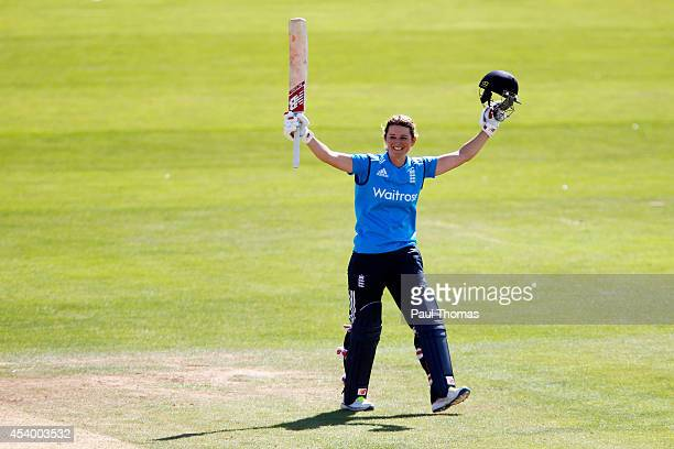 Charlotte Edwards of England celebrates reaching 100 runs during the 2nd Royal London ODI between England and India at North Marine Road on August 23...