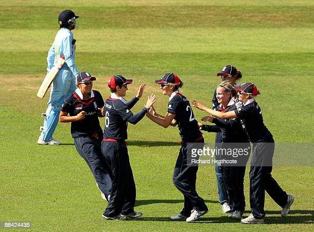 Charlotte Edwards of England celebrates taking a catch to dismiss Anjum Chopra of India during the ICC Women's Twenty20 World Cup match between India...