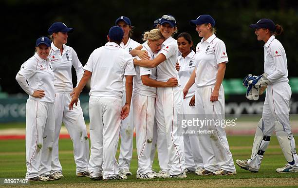 Charlotte Edwards of England hugs Katherine Brunt after she took the wicket of Jodie Fields during Day One of The 1st Test between England Women and...