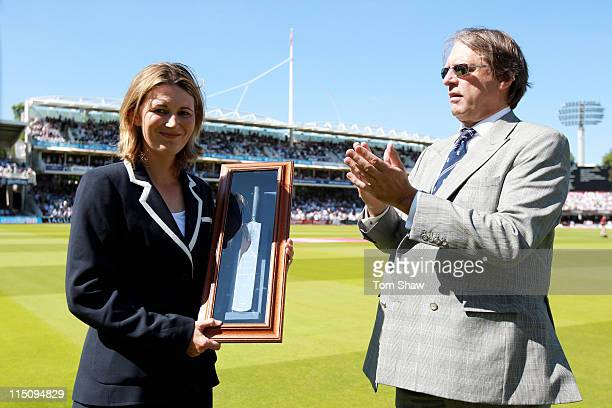 Charlotte Edwards of England is presented with an engraved silver bat by ECB Chairman Giles Clarke after becoming the most capped female cricketer in...